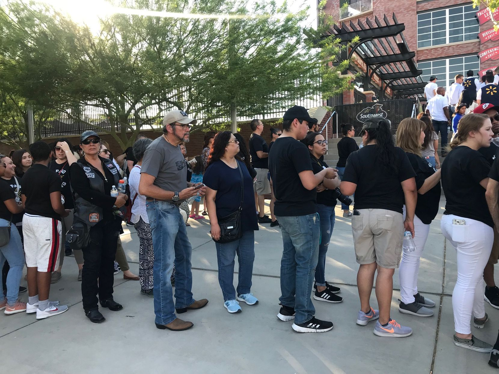 People wait to enter the ballpark shortly before the memorial got under way.