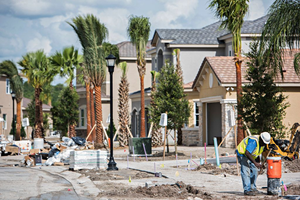 Housing construction at the The Ridge at Wiregrass community in Wesley Chapel, north of Tampa, Florida. Some lenders are beginning to issue mortgages to borrowers with troubled credit records and to issue bonds backed by those loans. The market for such loans and bonds has remained largely dormant since the financial crisis. (Melissa Lyttle/The New York Times)