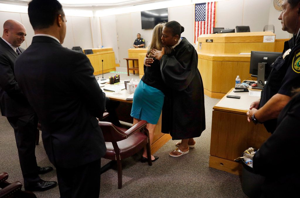 Amber Guyger and District Judge Tammy Kemp embraced Wednesday after the end of Guyger's murder trial.