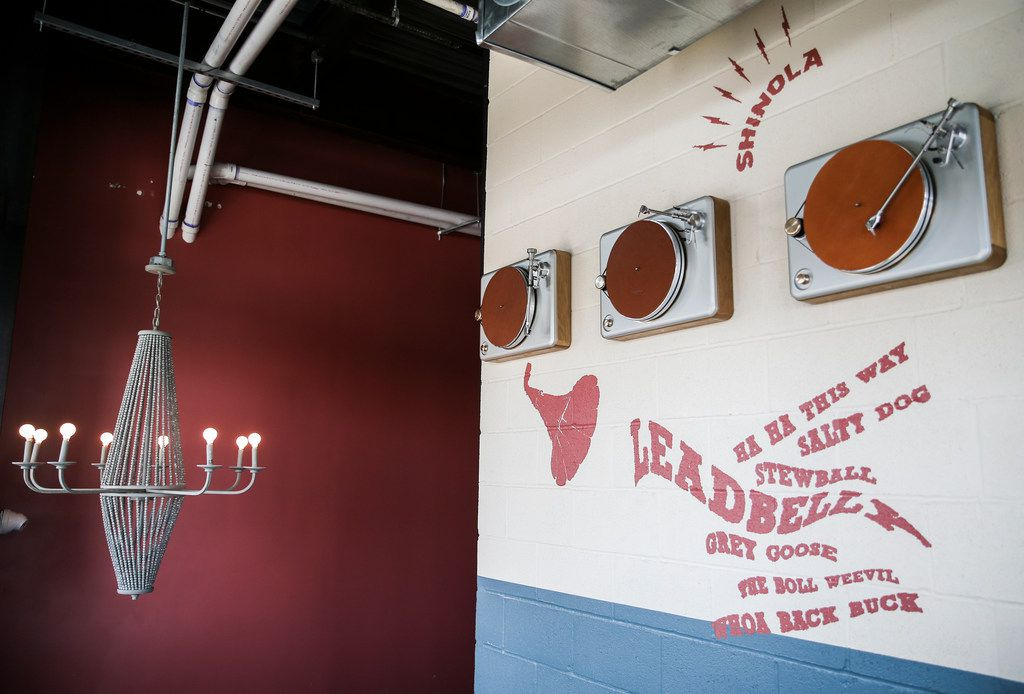 Record players hang above a staircase at Punch Bowl Social on Thursday, June 27, 2019 in Dallas. (Ryan Michalesko/The Dallas Morning News)