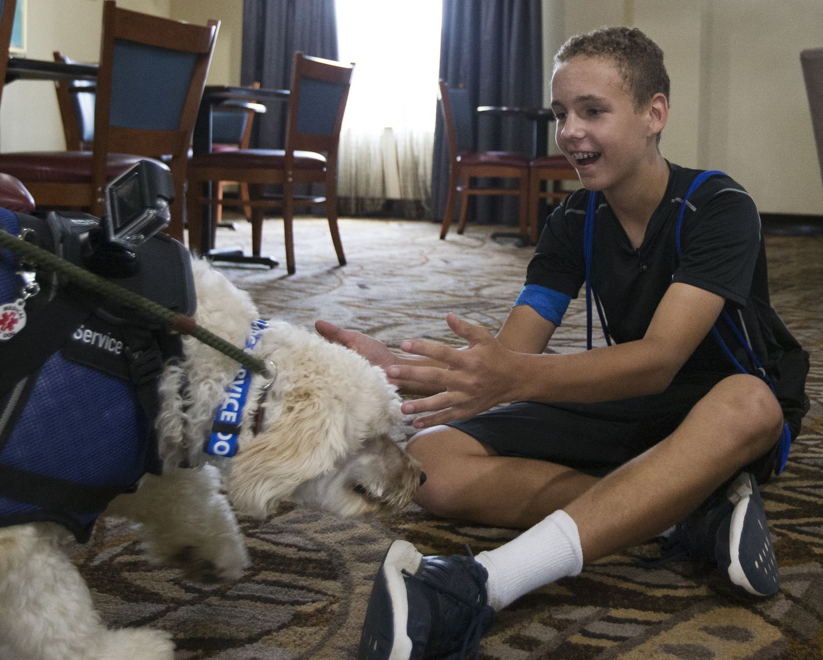 Brian Ellis welcomes Callie into his arms after months of being away from each other while she was trained to be a diabetic alert dog, at a hotel in Eastland.