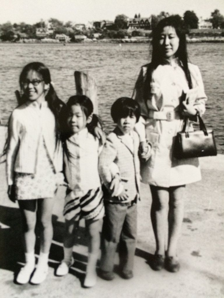 Thomas Huang clutches his mother's hand, his right arm is entwined with his sister's. Decades later, it is the children who must slow down so their mother can keep up.