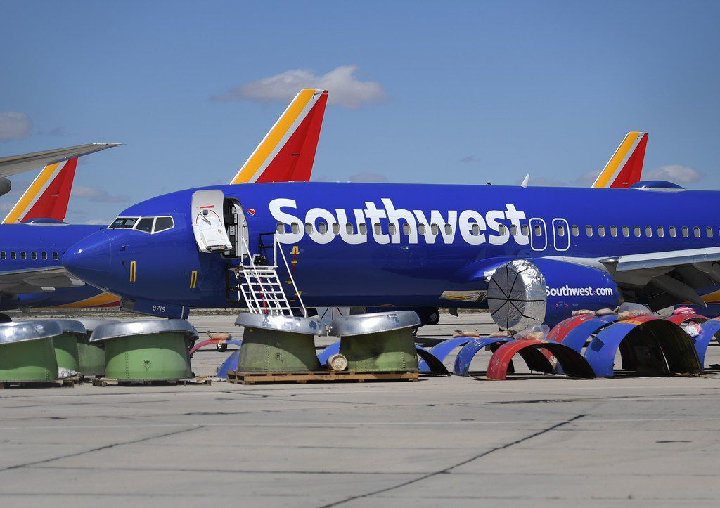After being grounded, Southwest Airlines Boeing 737 MAX aircraft are parked on the tarmac at the Southern California Logistics Airport in Victorville.