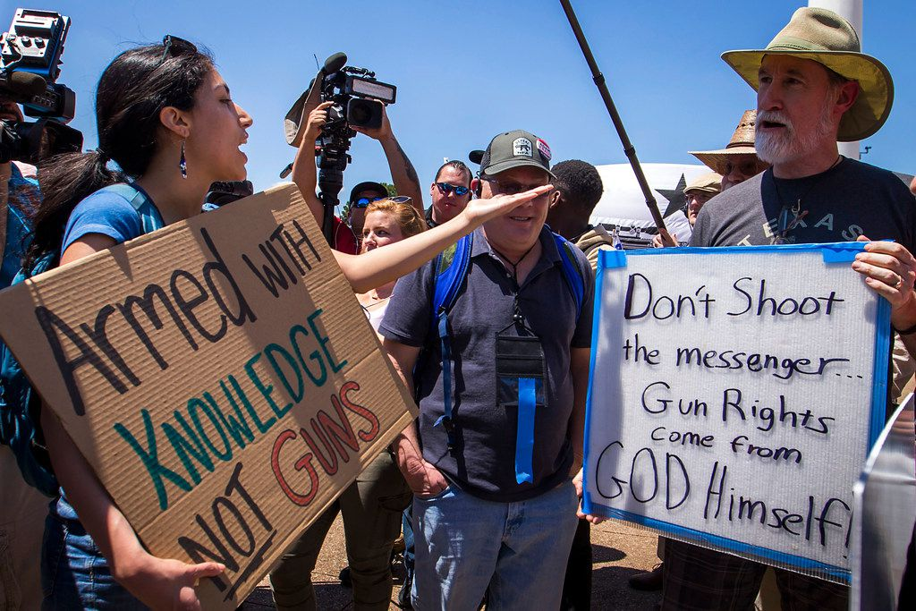Dueling groups demonstrated outside Dallas City Hall during the NRA Annual Meeting & Exhibits at the Kay Bailey Hutchison Convention Center on Saturday.
