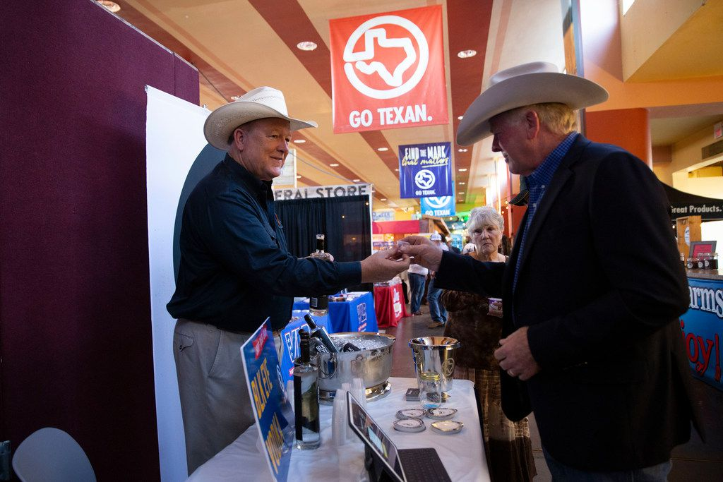 Todd Gregory, of Black Eyed Distilling Company, gives samples of vodka at the Go Texan Pavilion at State Fair of Texas.