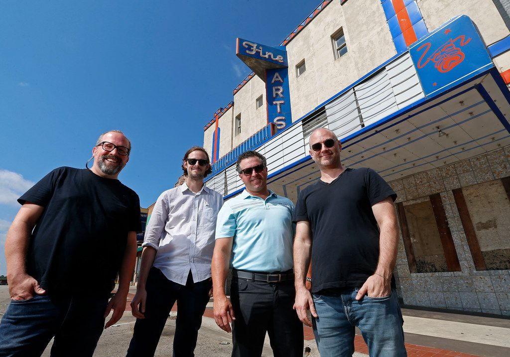 From left, Artist Martin Iles, Aviation Cinemas CEO Barak Epstein, Alex Payne of Axis Realty Group and Jason Reimer in front of the historic Fine Arts Theater in the Denton square
