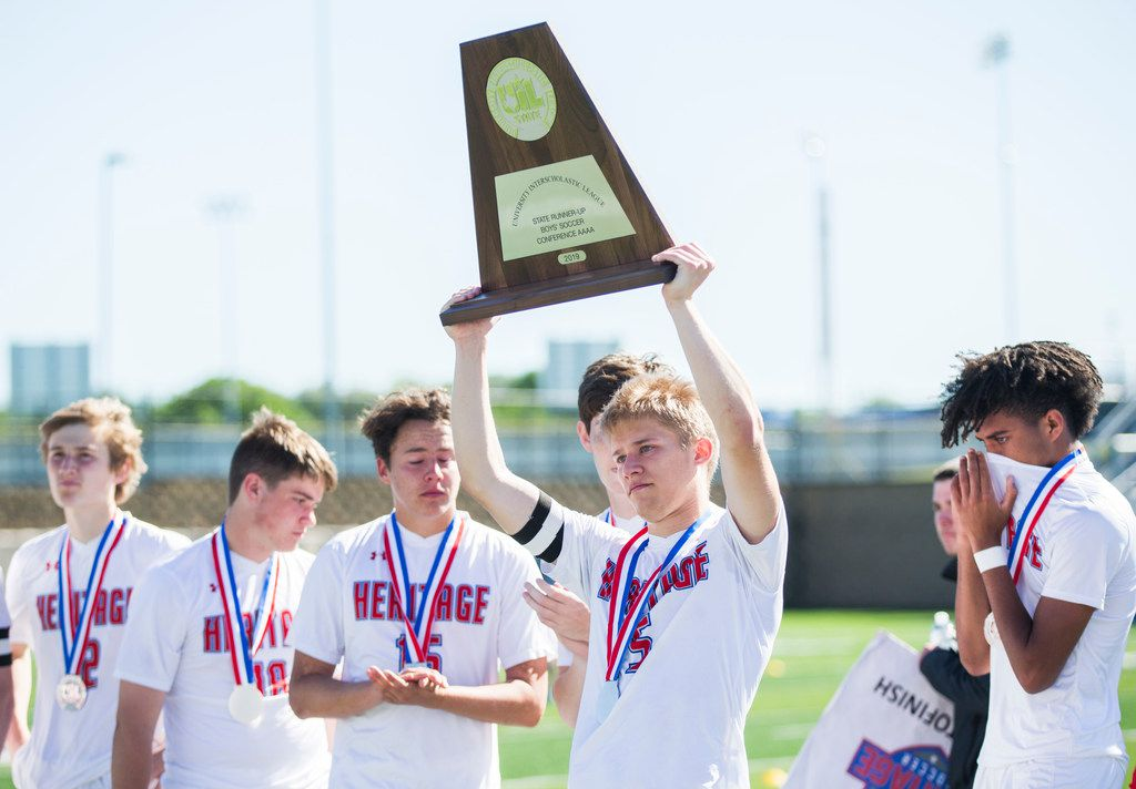 Midlothian Heritage defender Trace LaFrenz (5) holds up a second place trophy after Midlothian Heritage lost 1-0 in overtime of a UIL conference 4A boys state championship soccer game between Midlothian Heritage High School and San Elizario High School on Friday, April 19, 2019 at Birkelbach Field in Georgetown, Texas. (Ashley Landis/The Dallas Morning News)