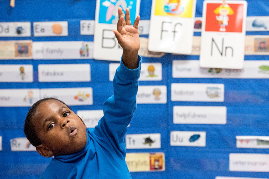 Preschooler Kameron Davis, 5, raises his hand to answer a question about nutrition during a class discussion on Friday, December 9, 2016 at Wilmer Early Childhood Center in Wilmer, Texas. (Jeffrey McWhorter/Special Contributor)