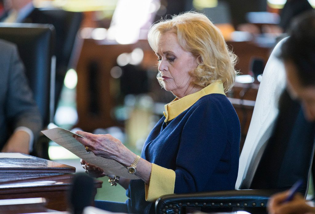 Senator Beverly Powell looks over documents at her desk on the second day of the 86th Texas legislature on Wednesday, January 9, 2019 at the Texas state capital in Austin, Texas.