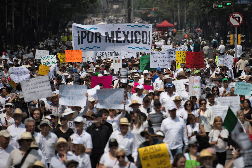 """People take part in the so-called """"March of Silence"""" against Mexican President Andres Manuel Lopez Obrador's policies in Mexico City, on May 5, 2019.."""