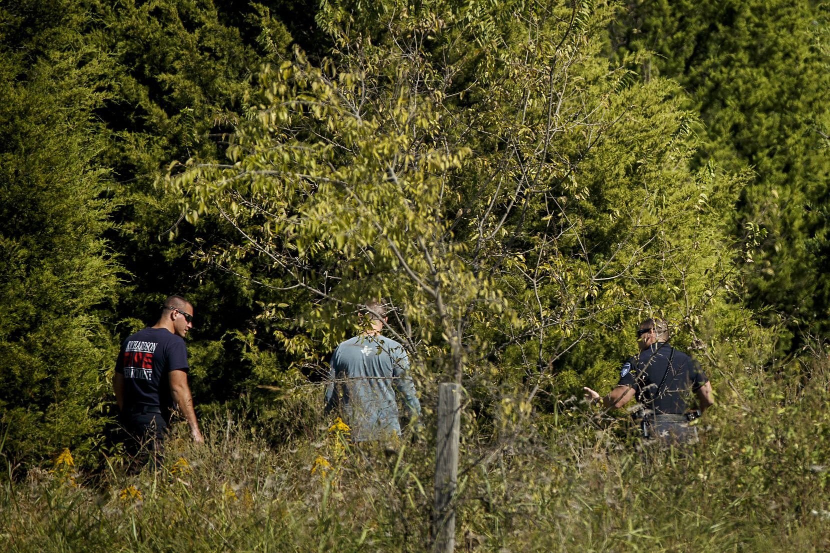 Police head into a wooded area as they search for Sherin Mathews last week on the campus of Richland College in Dallas.