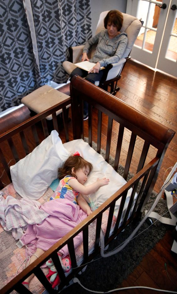 Home health pediatric nurse Audrey Jakubowski keeps a watchful eye on 2 year-old Christina Gregory as she takes a nap. The Gregory's have two pediatric nurses that work around the clock to ensure Christina doesn't stop breathing at their Southlake,Texas home, Tuesday, January 31, 2017. Christina suffers from CCHS (Congenital Central Hypoventilation Syndrome), a genetic disorder that affects her breathing. The Gregorys are affected by Texas' change to their Medicare healthcare coverage, switching to a MCO plan from an HMO plan, limiting their care to within the region -a cumbersome issue for families dealing with 24/7 care. (Tom Fox/The Dallas Morning News)