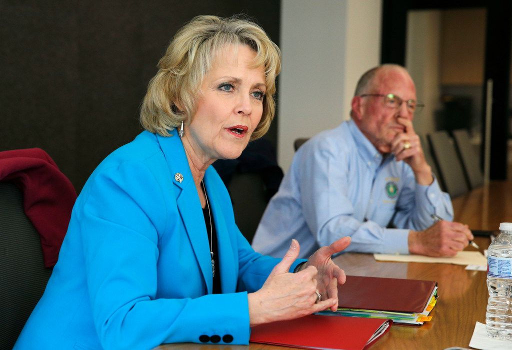Rep. Cindy Burkett, R-Sunnyvale answers questions as State Sen. Bob Hall, R-Edgewood listens at The Dallas Morning News. Burkett is challenging Hall for his state senate seat.