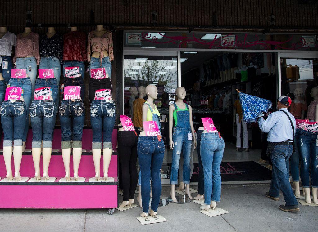 A shopper enters a clothing stores along El Paso Street in downtown El Paso. Mexico is Texas' No. 1 trading partner.