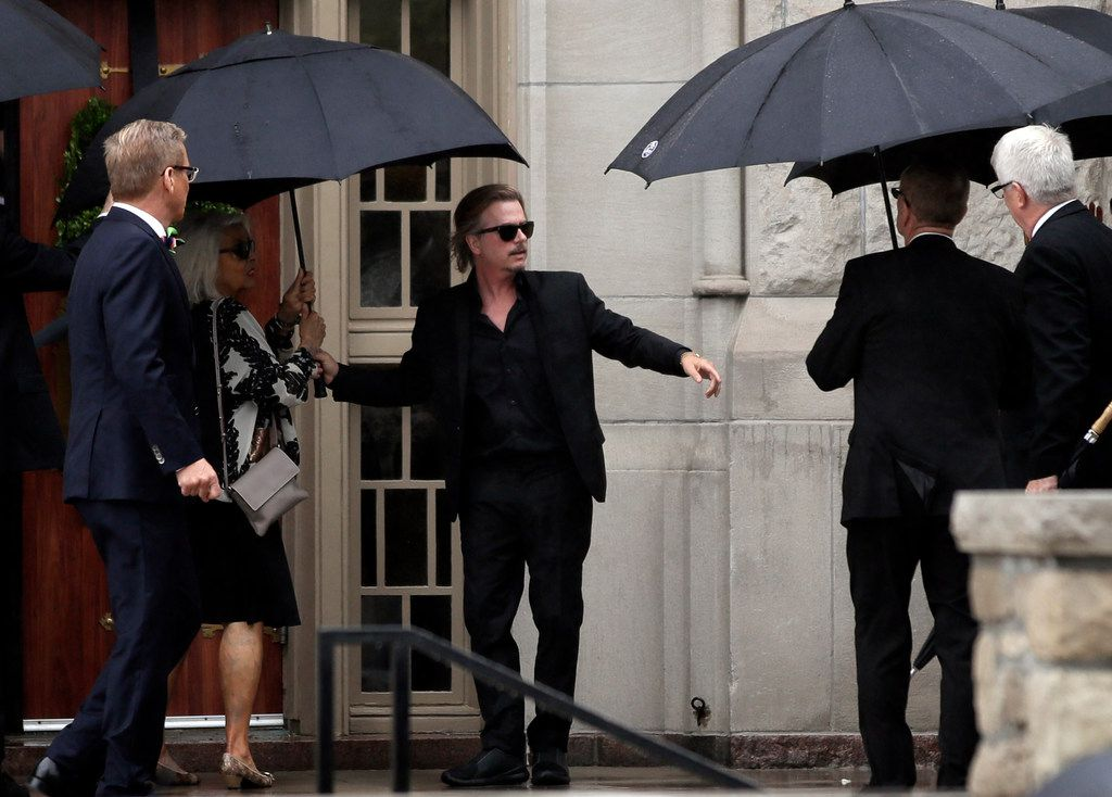 Actor-comedian David Spade helps family members enter Our Lady of Perpetual Help Redemptorist Catholic Church for funeral services for his sister-in-law, designer Kate Spade, in Kansas City, Mo., Thursday, June 21, 2018.  (AP Photo/Orlin Wagner)
