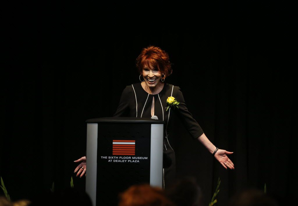 In this 2016 file photo, author Sandra Brown accepts her award during the Press Club of Dallas's Legends in Journalism awards at the Sixth Floor Museum in Dallas.