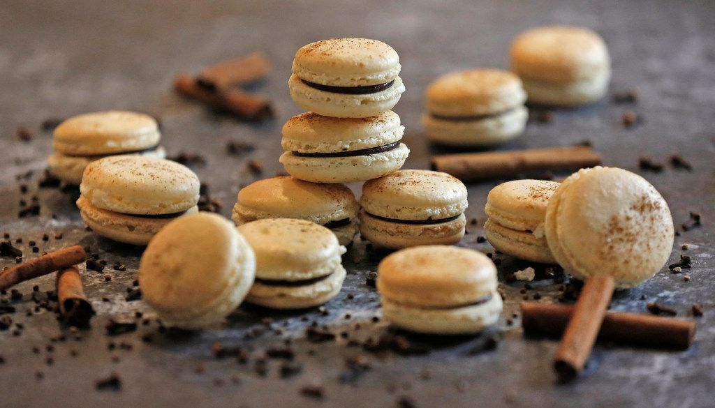 Basic macaron shells are filled with Chocolate Chai Spice Ganache and sprinkled with more chai spice.