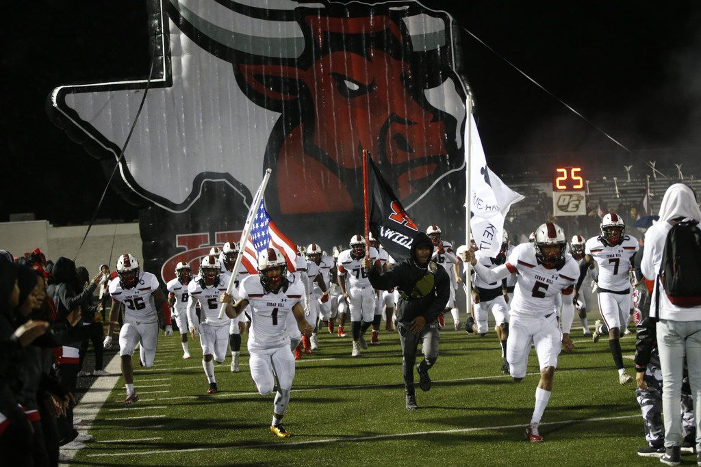 Cedar Hill takes the field in the second half of their game against DeSoto at Eagle Stadium in DeSoto, Texas on Nov. 8, 2018. Cedar Hill won the game 32-17. (Nathan Hunsinger/The Dallas Morning News)