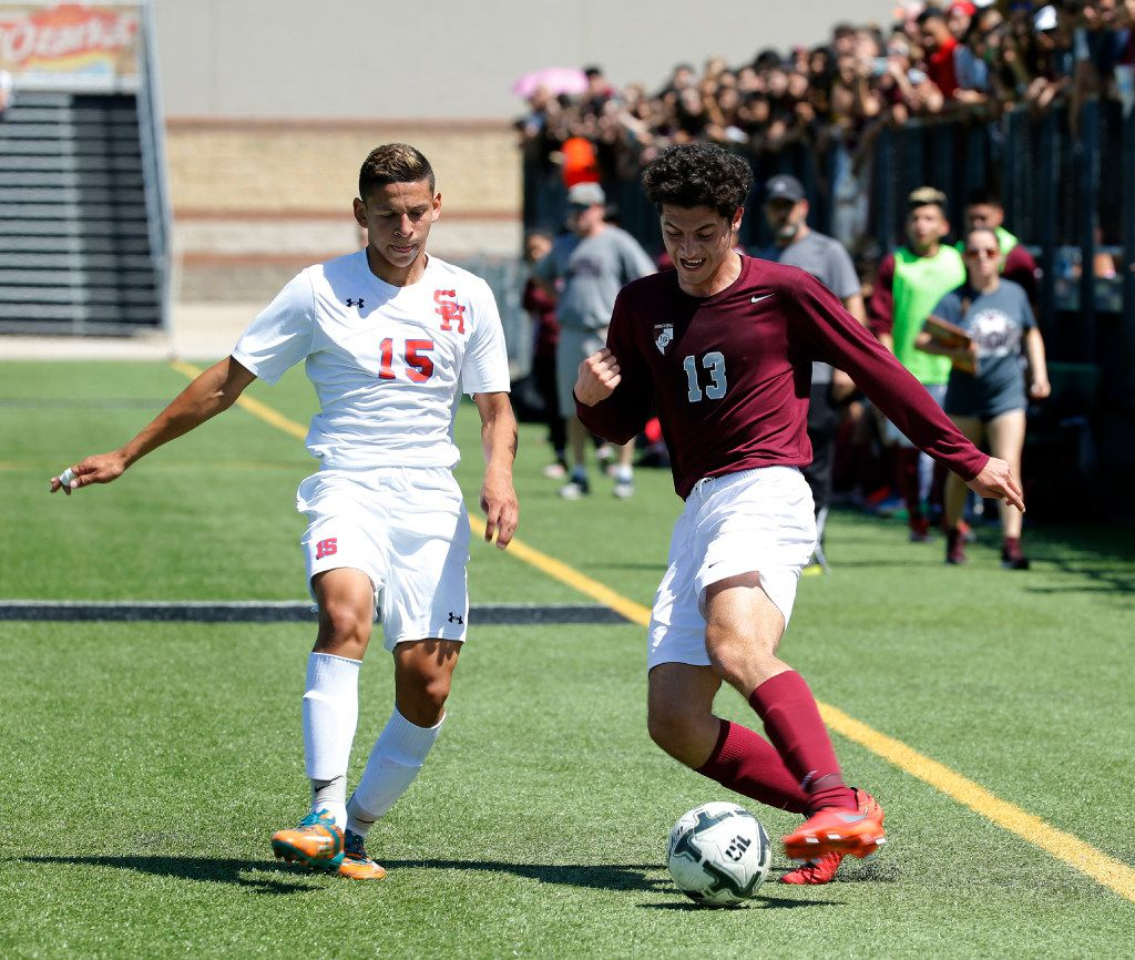 Sam Houston player Jose Ortiz (15) battles with Lewisville player Carlos Galvan (13) during the first half of the 6A Region 1 semi-final game at Dragon Stadium in Southlake, Texas on Friday, April 7, 2017. Sam Houston won 3-2. (Rose Baca/The Dallas Morning News)