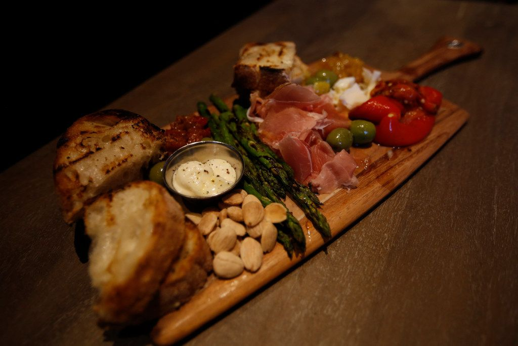 The Chef's Board, with Prosciutto di Parma, artisan cheese, marinated eggplant, roasted pepper, Castelvetrano olive, and Marcona almonds, served at North Italia, at Legacy West, in Plano, Texas, Friday, June 23, 2017.