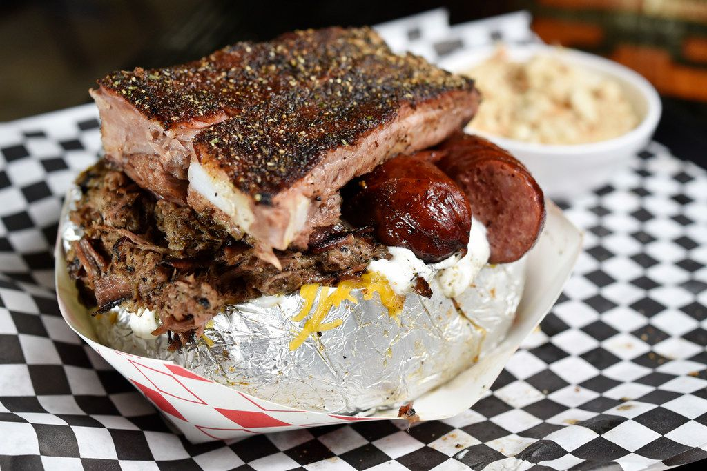 The MVP three-meat baked potato with brisket, sausage and ribs, served with a side of banana pudding, from Winners BBQ in Plano, Sept. 13, 2019.