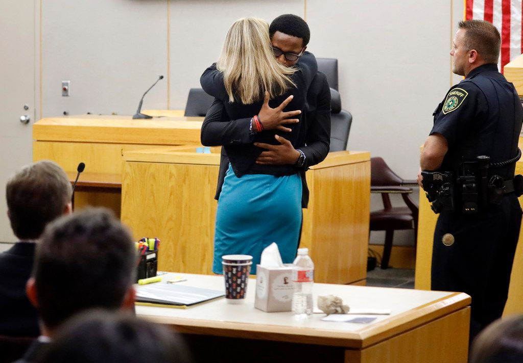 "Botham Jean's brother Brandt Jean hugged defendant Amber Guyger after delivering his impact statement to her following her 10-year prison sentence for murder at the Frank Crowley Courts Building on Wednesday. George Milner, a veteran Dallas criminal law attorney, said he didn't think Kemp compromised security by allowing Jean's younger brother to hug Guyger.  ""As the judge would have known, security was unusually tight,"" he said."