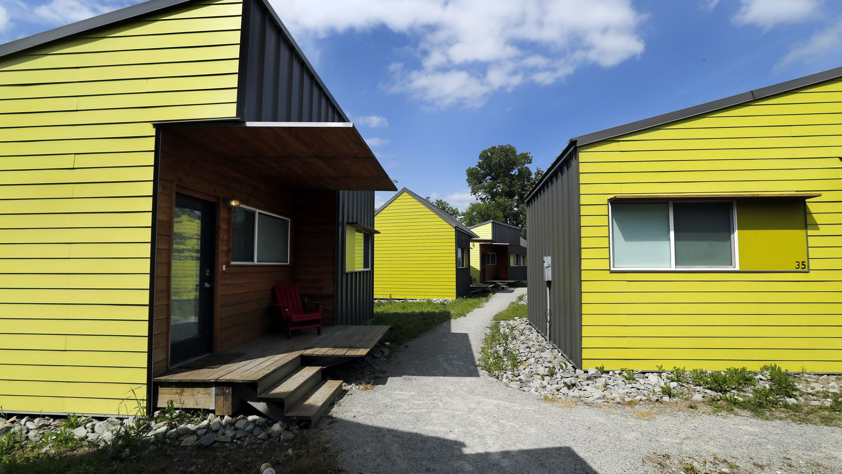 The Cottages at Hickory Crossing have brightly colored units with pathways between them. The units are designed by BC Workshop.