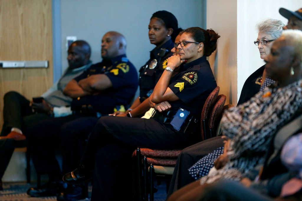Dallas officers listened last month at a news conference as Hall announced the new command structure.