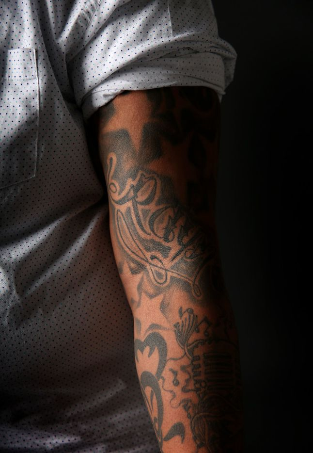 One of Trenton Johnson's arms features a tattoo of his goddaughter's name Ray, short for Rayne. (Rose Baca/The Dallas Morning News)