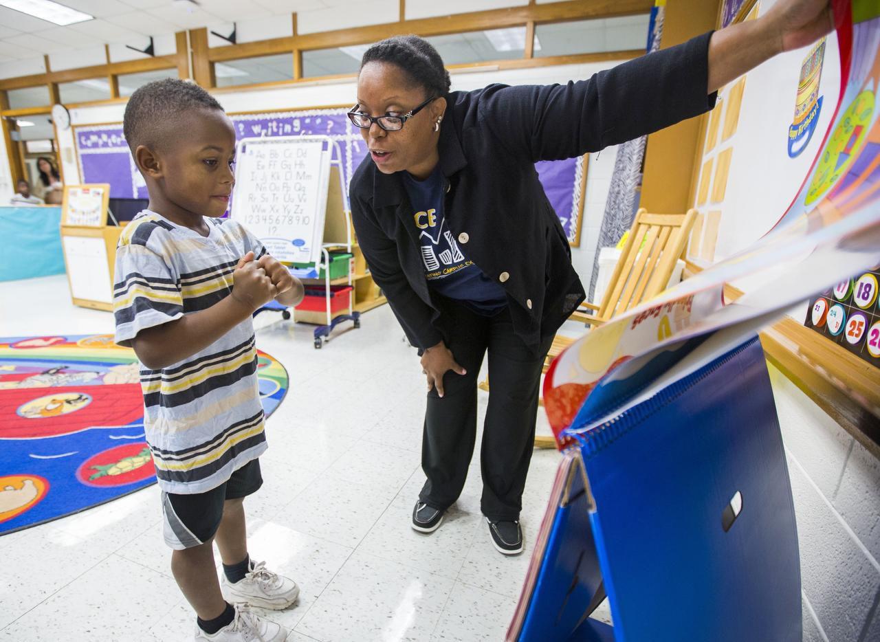 Marlan Whyte, 5,  got a peek at kindergarten with teacher Stacye Cunningham last week at Blanton Elementary.