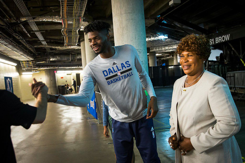 Dallas Mavericks forward Nerlens Noel shakes hands with a fan in the tunnel with his mother Dorcina before an NBA basketball game at American Airlines Center on Friday, March 10, 2017, in Dallas. (Smiley N. Pool/The Dallas Morning News)