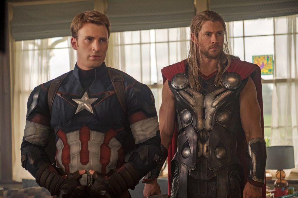 """This photo provided by Disney/Marvel shows, Chris Evans, left, as Captain America/Steve Rogers, and Chris Hemsworth as Thor, in the new film, """"Avengers: Age Of Ultron."""" The movie releases in U.S. theaters on May 1, 2015."""