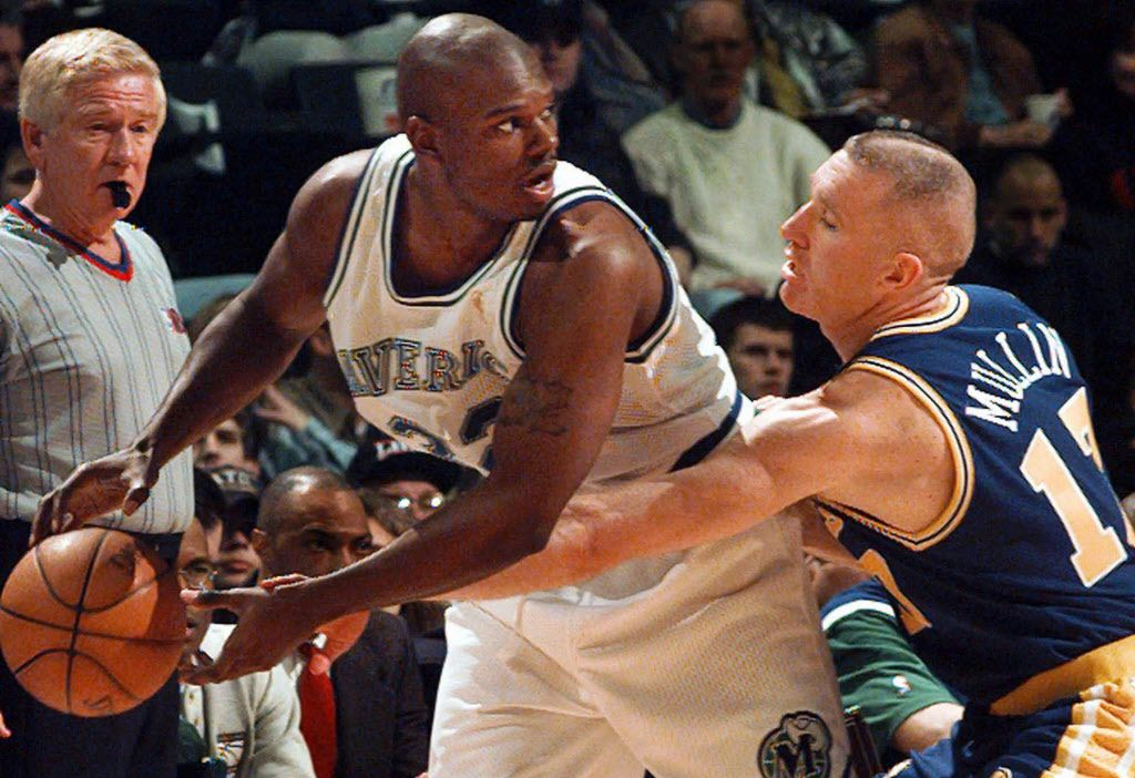 Golden State Warriors' Chris Mullin (17) reaches for the ball against Dallas Mavericks  Jamal Mashburn (32) during the first quarter in Dallas, Thursday, Feb. 13, 1997. Looking on is referee Jess Kersey.