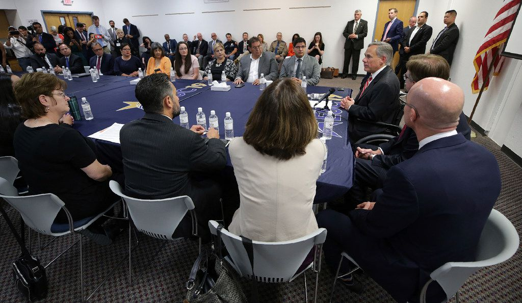 Texas Gov. Greg Abbott speaks with families of victims and survivors of the Aug. 3 shooting at Walmart in El Paso on Aug. 29, 2019. About 30 representatives from law enforcement and non-governmental agencies were part of a round-table discussion of public safety.