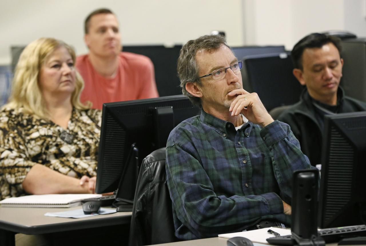 Larry Jones (center), a marine veteran, listens to his instructor. Collin College is one of 17 colleges in Texas to offer training programs for veterans as part of the Texas Workforce Commission's Veterans and Industry Partnership.
