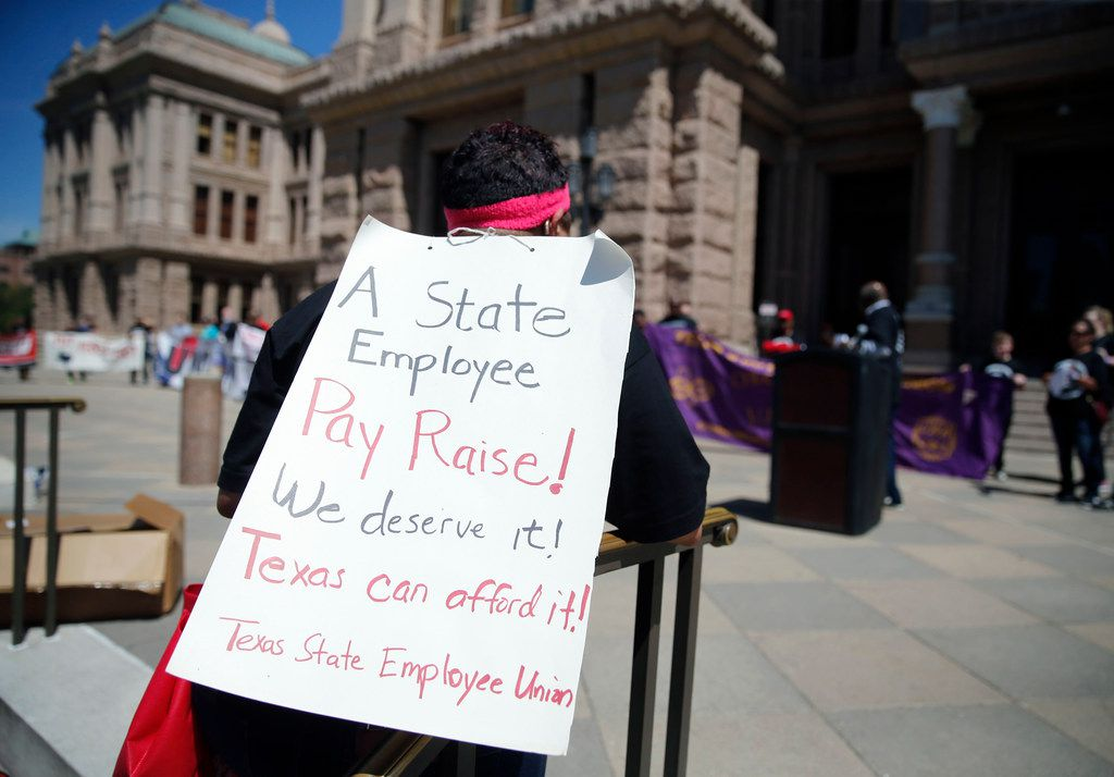 Sonia Tillman, a parole officer from Dallas, participated in a rally Wednesday to support pay raise for state employees at the Texas Capitol in Austin.