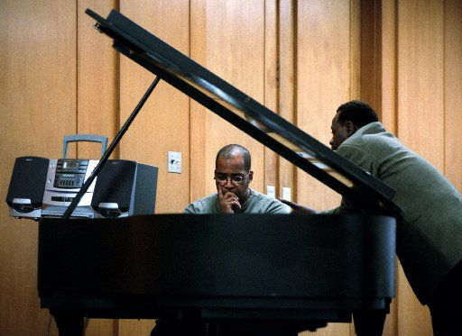 """Charles Winslow (left) conferred with Keenan Zeno at a rehearsal for """"Three Guys Named Moe"""" at The Black Academy of Arts and Letters in Dallas in 2001. (File Photo/Staff)"""