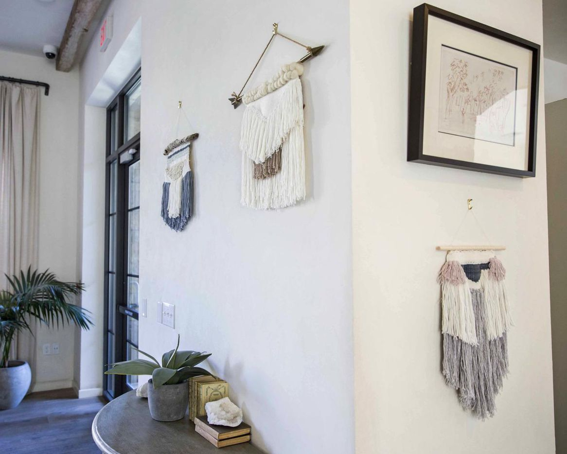 Woven wall hangings made by Rebekah Wright are on display on Friday, April 8, 2016 at Upper East Cafe in the Upper East Apartments at the Village in Dallas