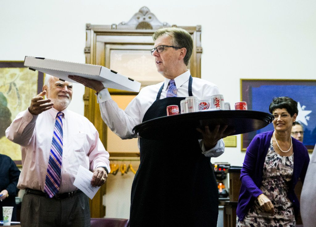 Lt. Gov. Dan Patrick served pizza and soda inside the Senators' Room just before the Senate reconvened at 12:01 a.m. for a third reading of the sunset bill Thursday during the third day of a special legislative session at the Texas Capitol in Austin.