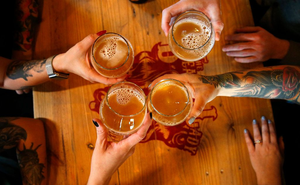 (clockwise from lower left) Sarah Allen, Shannon Osbakken, Hugh Morris  and Lisa Smith share a barrel-aged craft brew at The Bearded Lady on 7th Ave in Fort Worth , Friday, January 20, 2017. The large bottles of beer called bombers are meant to be shared like a bottle of wine. (Tom Fox/The Dallas Morning News)