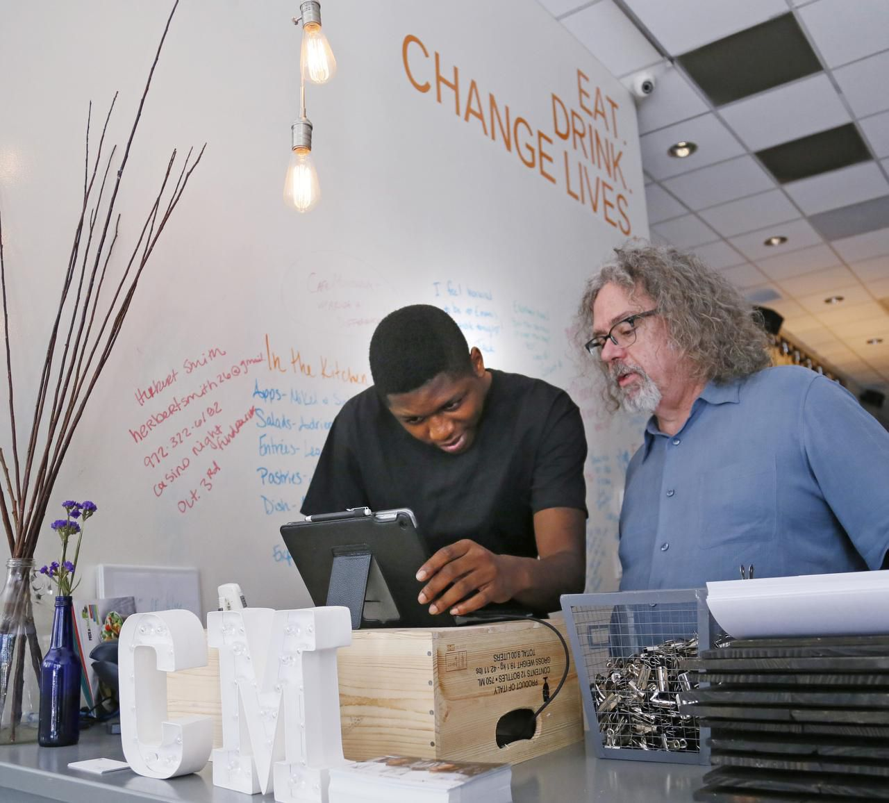 Malik Runnels (left) asks a question to Kenneth Pyron, director of operation at Café Momentum.