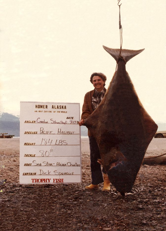 Caroline Hunt with her award-winning halibut that she caught in Homer, Alaska o,n a trip with her second husband, Buddy Schoellkopf.