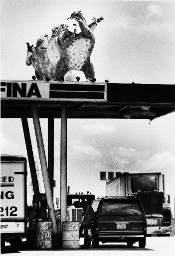 Three of the six Tango Frogs greet motorists as they gas up at Carl's Corner in 1984.  The other three frogs were touring the country.