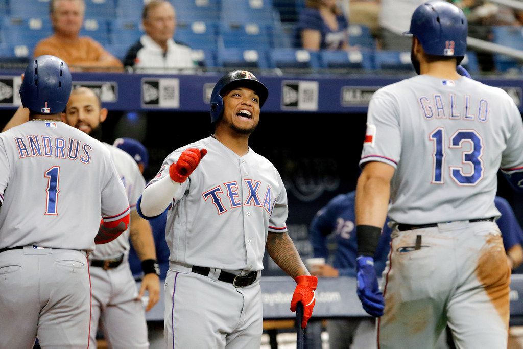 ST. PETERSBURG, FL - JUNE 30:  Willie Calhoun #5 of the Texas Rangers celebrates with teammate Joey Gallo #13 after Gallo's two-run home run, driving in Elvis Andrus #1 in the top of the fourth inning against the Tampa Bay Rays at Tropicana Field on June 30, 2019 in St. Petersburg, Florida. (Photo by Joseph Garnett Jr. /Getty Images)