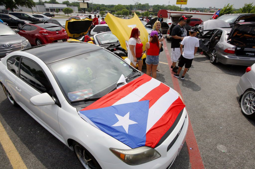 A Puerto Rican flag was displayed on a car during a car show at a Chinchorro party, hosted by the Puerto Rican Association of Dallas in May 2016 in Fort Worth. (Ben Torres/Special Contributor)