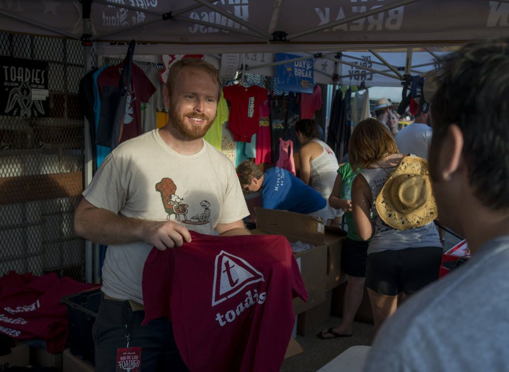Barry Townsend sells a Toadies t-shirt to a fan after the Toadies concert at Martin House Brewery in Fort Worth, Texas on June 26, 2016.