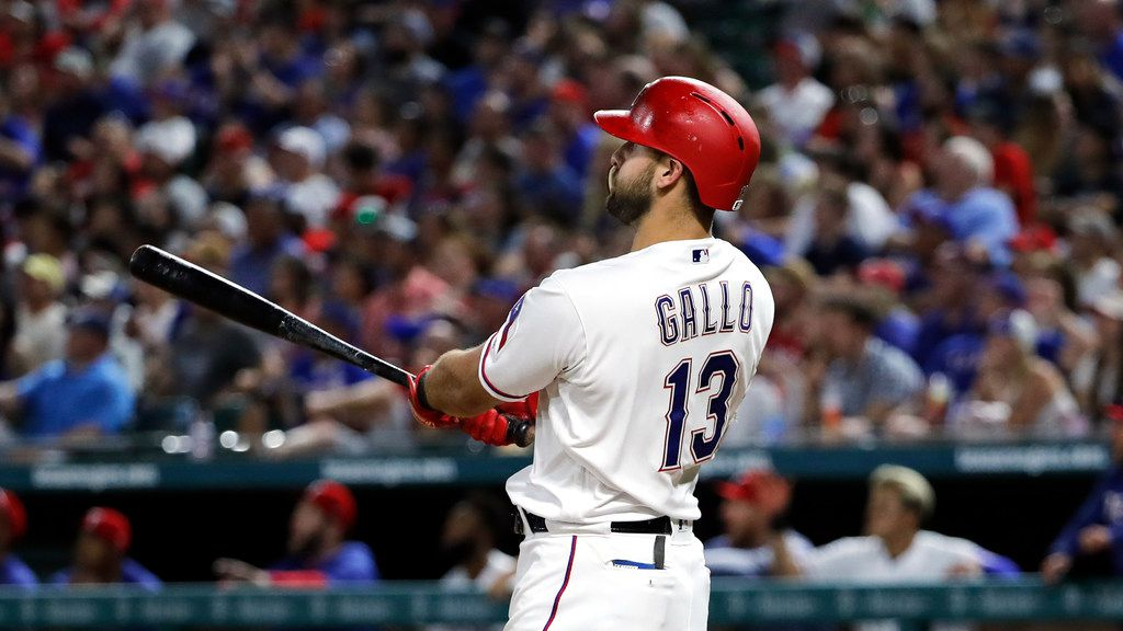 Texas Rangers' Joey Gallo watches the flight of his grand slam against the Kansas City Royals during a baseball game in Arlington, Texas, Friday, May 31, 2019. (AP Photo/Tony Gutierrez)