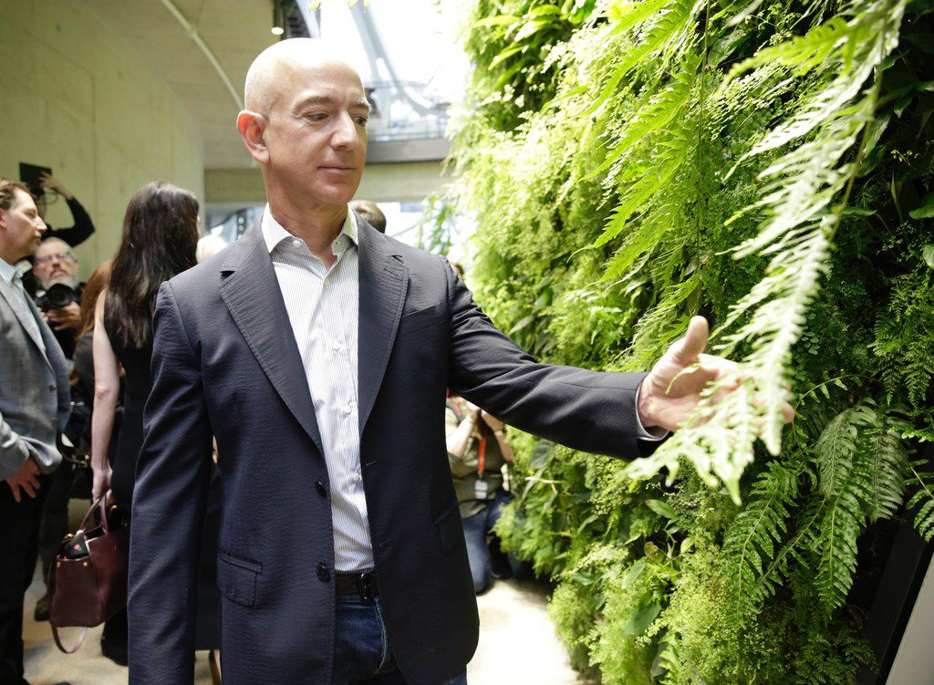(FILES) In this file photo taken on January 29, 2018 Chief Executive Officer of Amazon, Jeff Bezos, tours the facility at the grand opening of the Amazon Spheres, in Seattle, Washington.  Jeff Bezos is officially the richest person on the planet thanks to the success of Amazon -- but his bold vision extends to space and even time itself.With Amazon's share price up nearly 60 percent during the past year, the personal wealth of the company's 54-year-old founder has doubled to more than $110 billion. / AFP PHOTO / JASON REDMONDJASON REDMOND/AFP/Getty Images