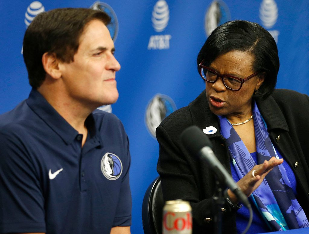 Dallas Mavericks interim CEO Cynthia Marshall advises Dallas Mavericks owner Mark Cuban on an answer as questions are asked about prior knowledge of recent events during a press conference at American Airlines Center in Dallas on Monday, February 26, 2018. Marshall has been hired by the Mavericks to help clean up after the recent sexual harassment scandal in the front office. (Vernon Bryant/The Dallas Morning News)