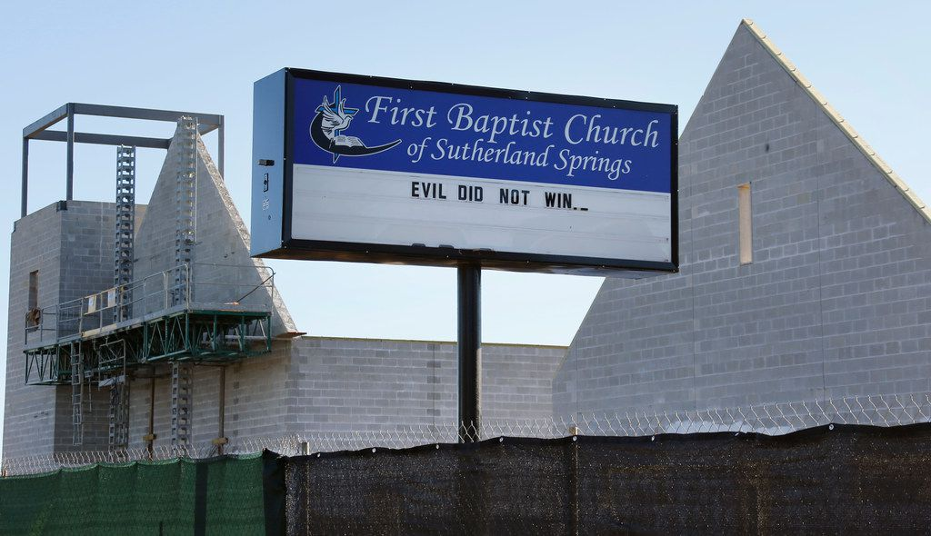 """The church sign at Sutherland Springs Baptist Church expresses the sentiment """"Evil did not win"""" as the new church building rises in the background in Sutherland Spring, Texas, photographed on Friday, November 2, 2018. November 5 is the one-year anniversary of the attack at the church, where 26 people were killed by a lone gunman at a Sunday morning worship service."""